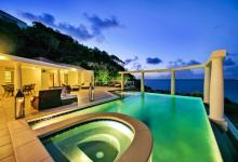 villa's outdoor pool by night